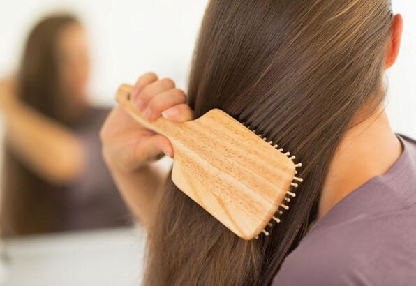 Combing hair with right brush